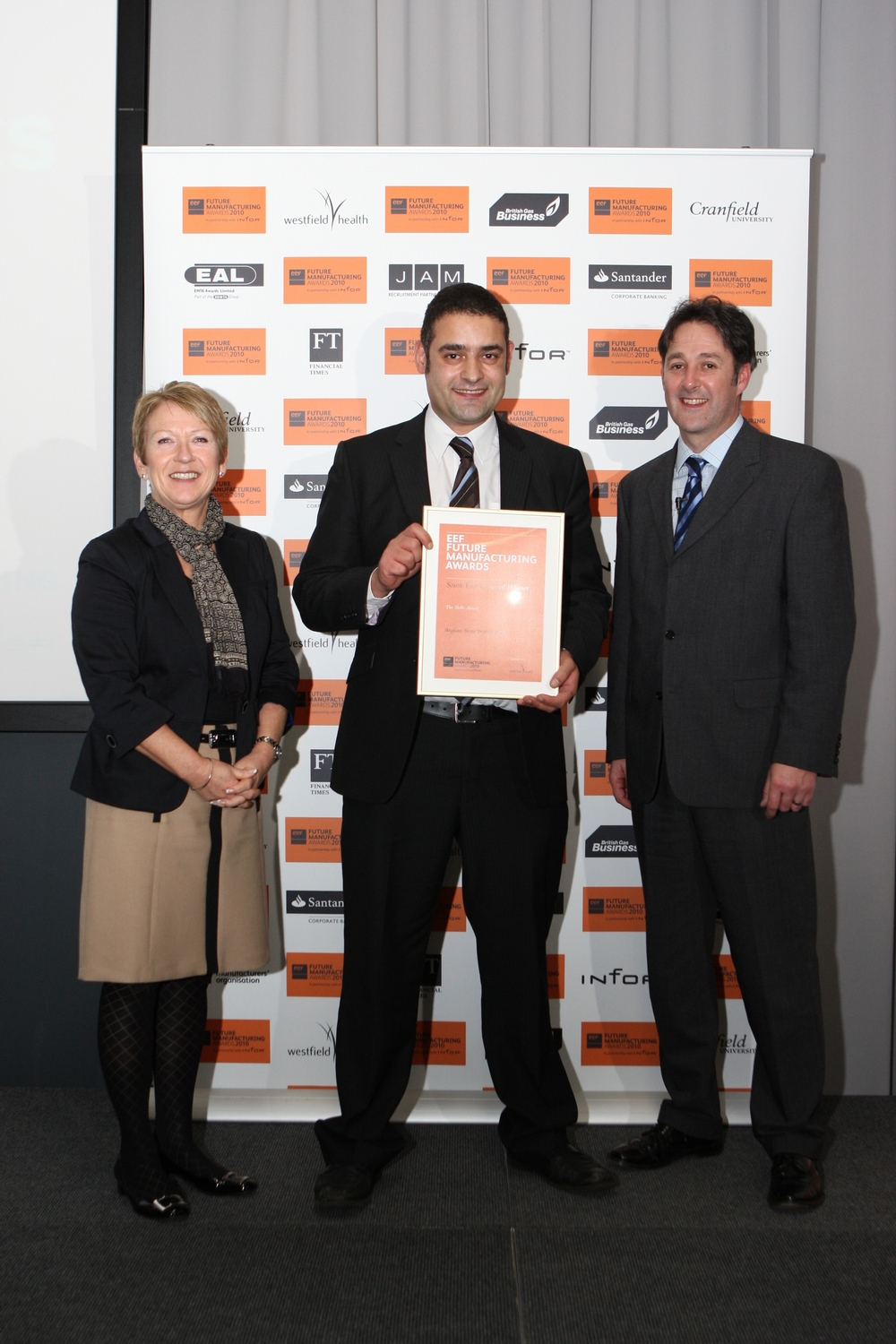 Stanley Peel with the EEF award for Anglian