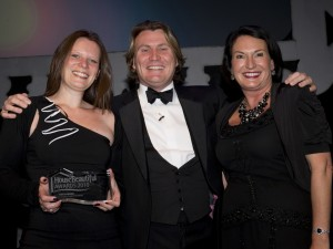 Caroline Mills and Melanie McDonald receiving the award from David Domoney