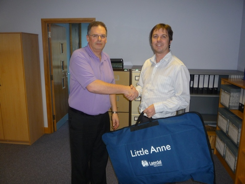 Paul Hair from Anglian handing over a CPR dummy
