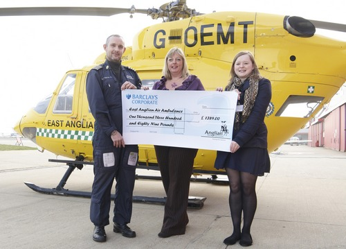 Anglian's Claire giving the cheque to East Anglian Air Ambulance
