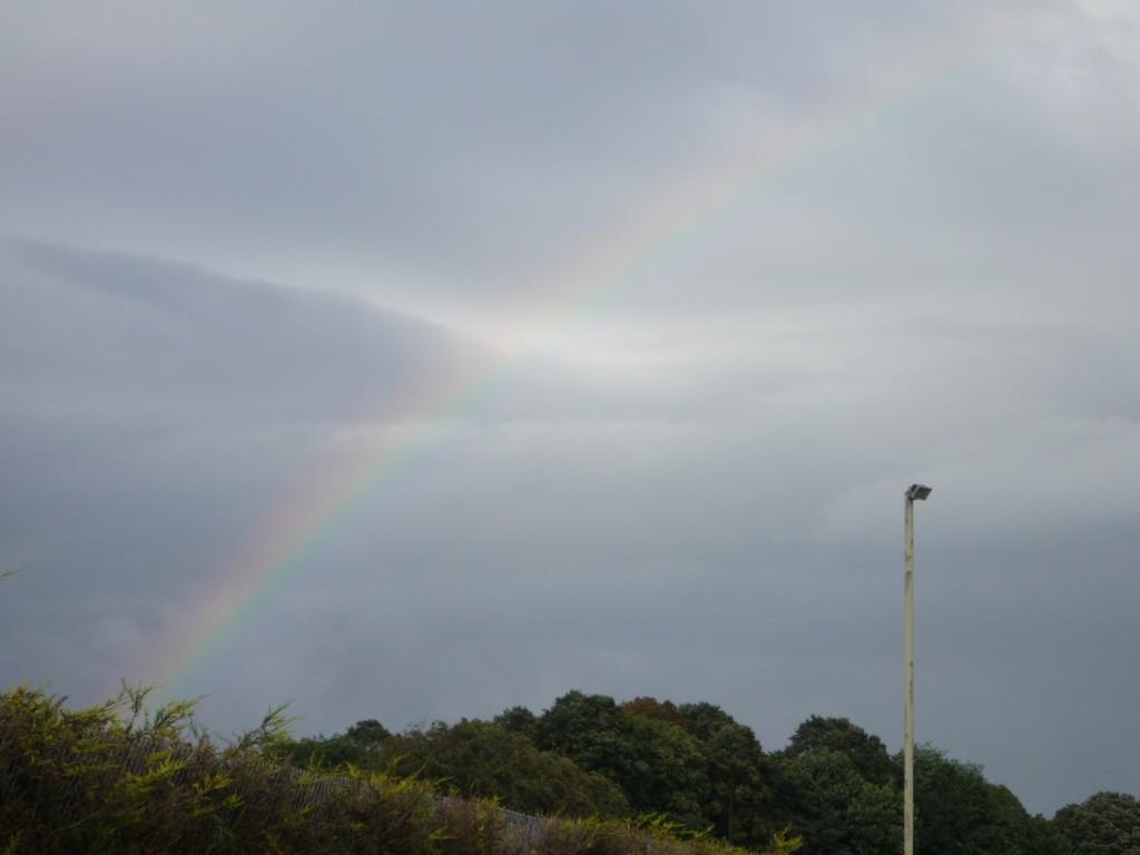 Rainbow through the torrential rain