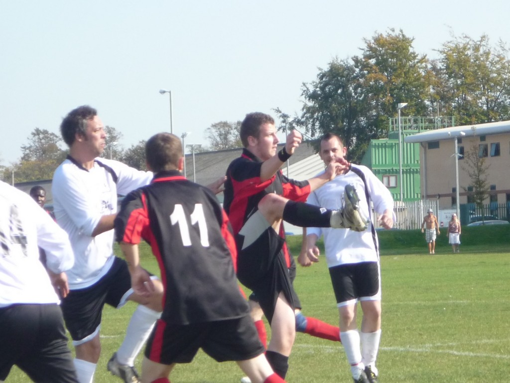 Ian Probert challenging the striker