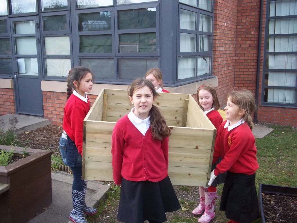 Gardening Club carrying a planter