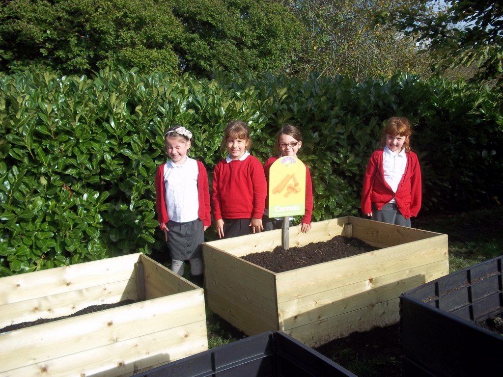 The Gardening Club with the planters