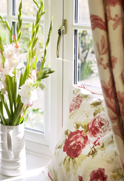 Floral curtains or cushions can add texture to a room