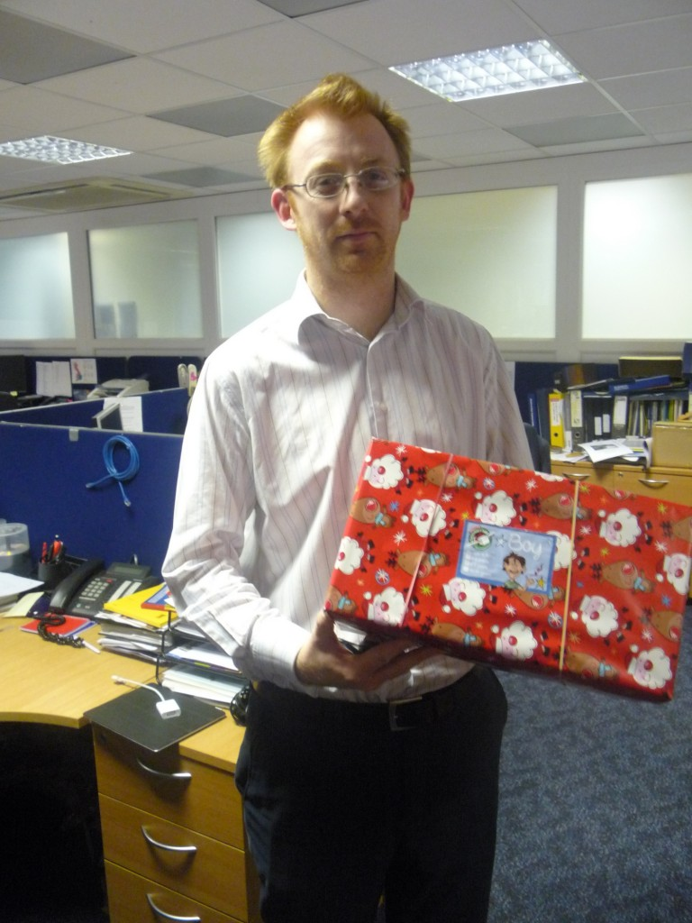 Dan Stagg with a present for Operation Christmas Child