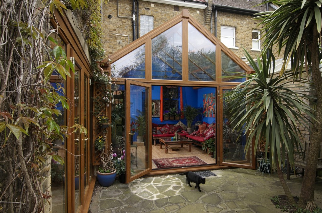 Plant filled garden and conservatory