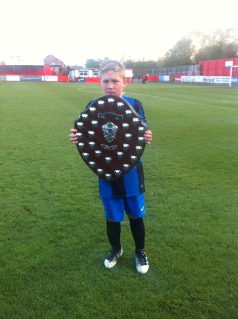 Cottage Farm Cup player with trophy