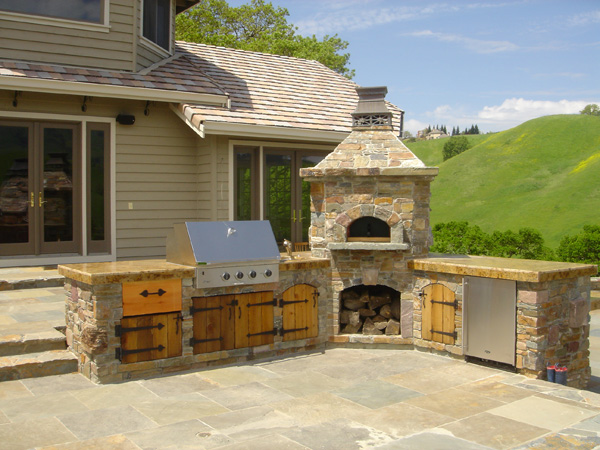 Outdoor kitchen complete with chimney