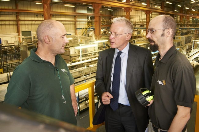 Norman Lamb discussing double glazing with factory workers