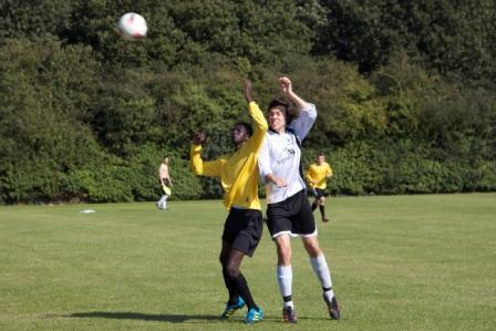 Josh Powley winning a header