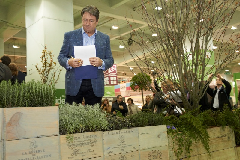 Alan Titchmarsh looking over a garden