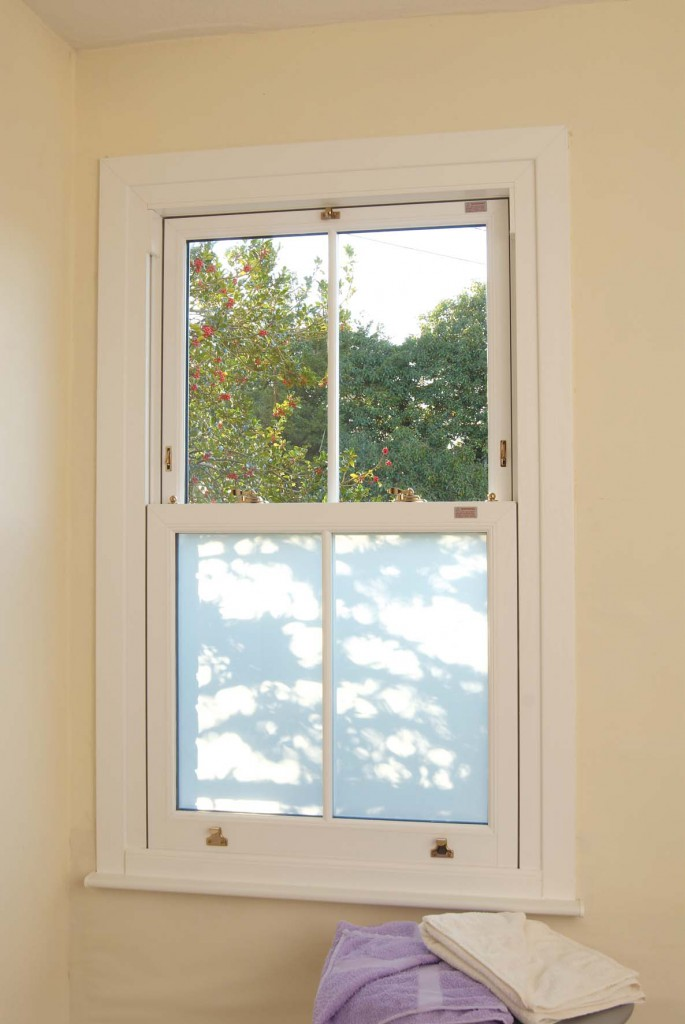 Opaque and clear glass in sash window