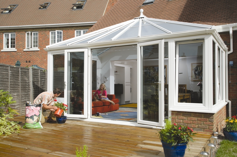 Anglian white conservatory with decking