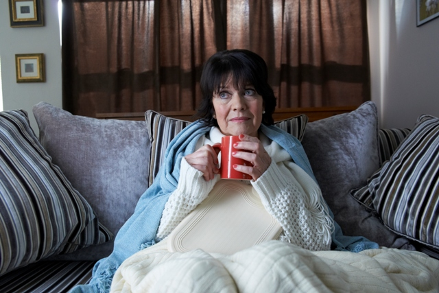 Sally Geeson wrapped up on the sofa
