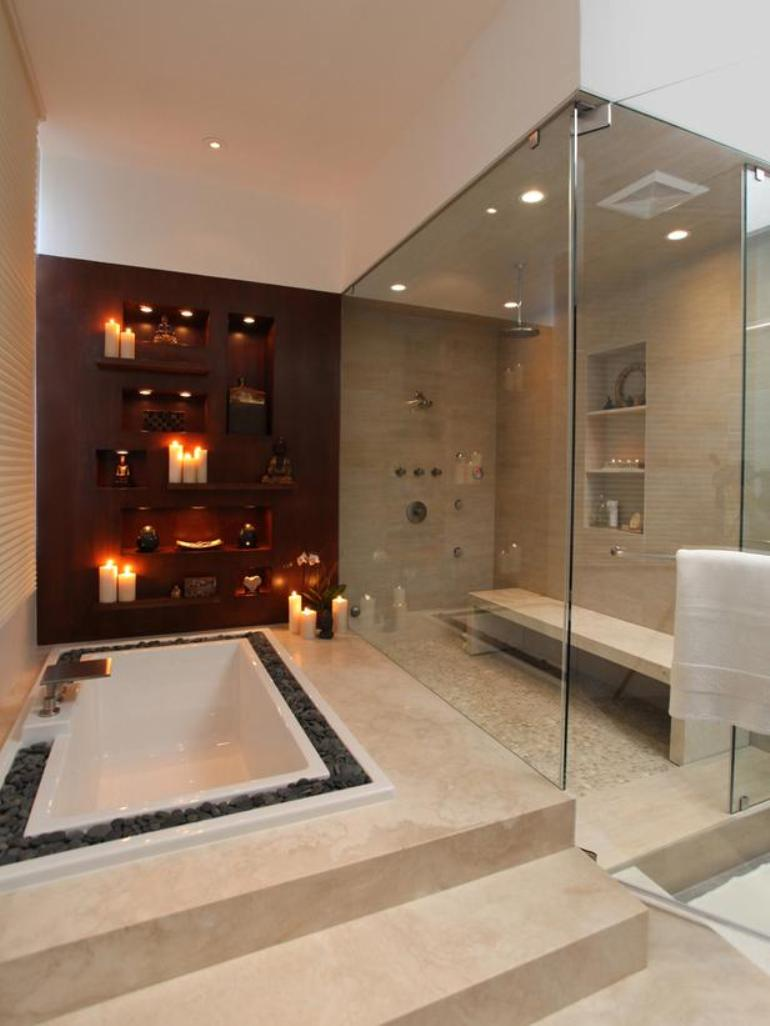Gravels Surrounding Built-in White Tub for Tranquil Sense and Lots of Candles Surrounding Tub for Romantic Sense