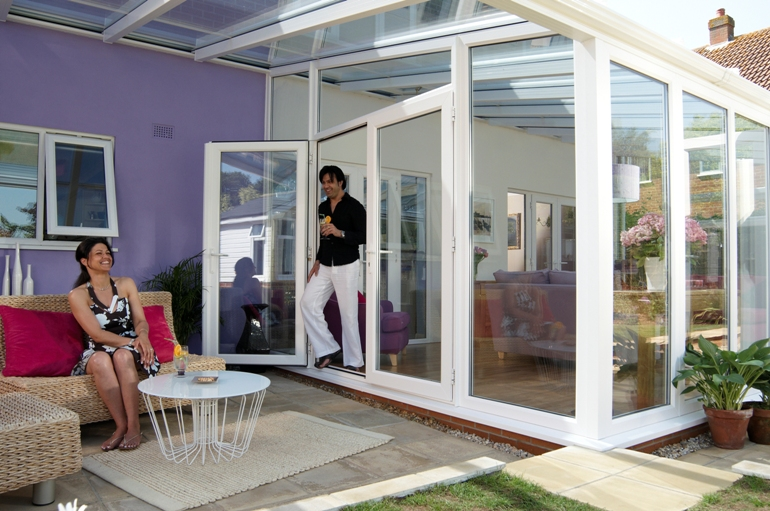 Couple enjoying their conservatory verandah
