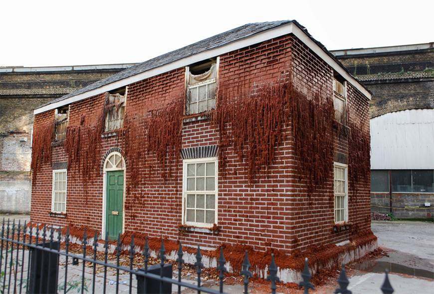 Alex Chinneck's Melting House in London