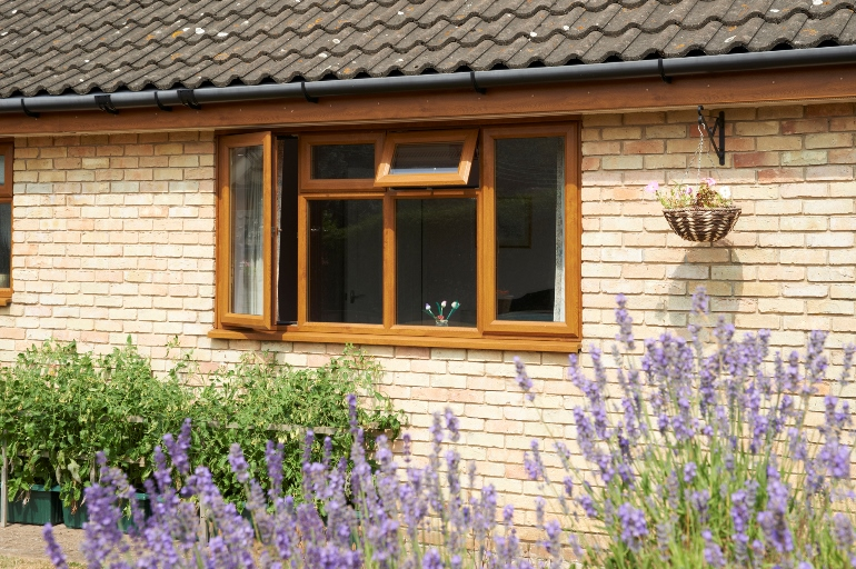 Double glazed golden oak window