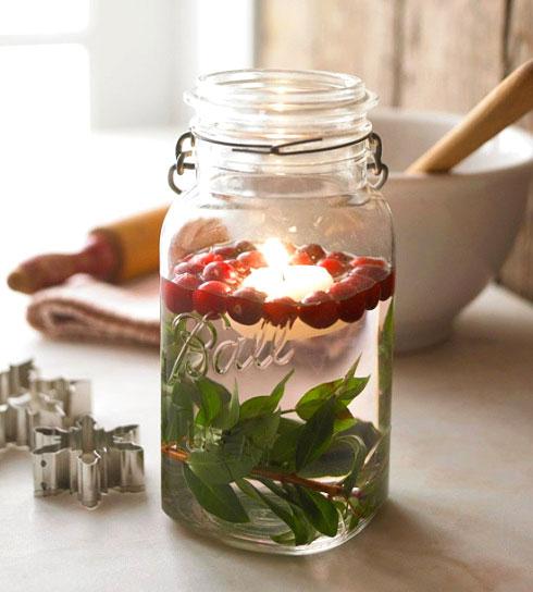 Homemade jam-jar floating candles.