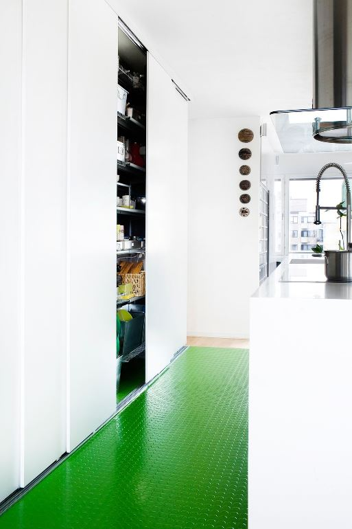 White kitchen with green rubber flooring