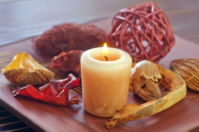 Candles and pot pourri in a cosy autumnal home