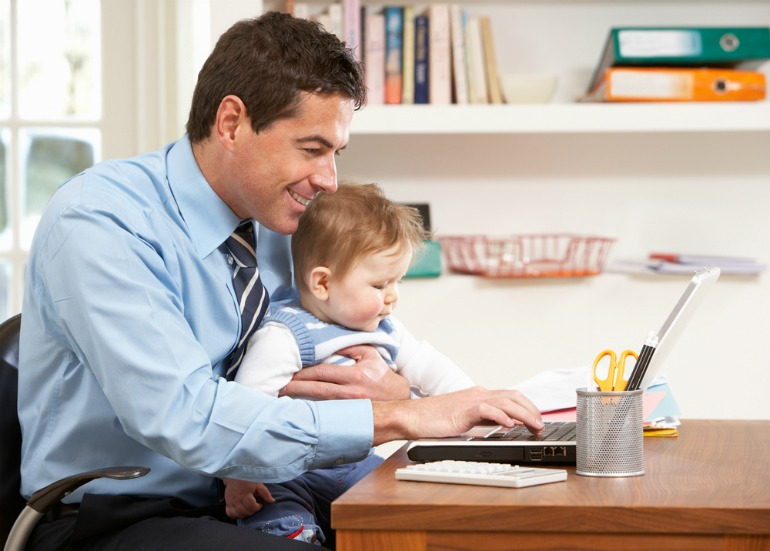 Image showing a parent working from home with his child