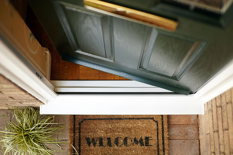 Front door and welcome mat