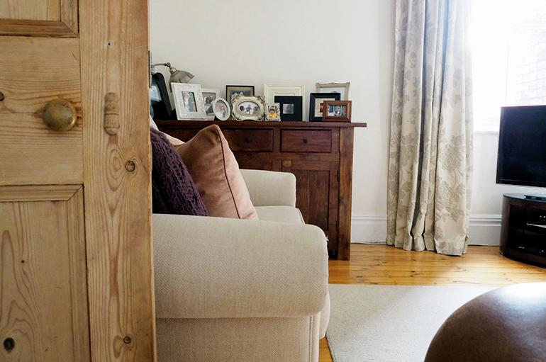 Neutral sofa, rug and curtains
