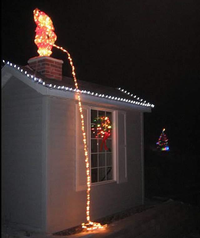 Santa Peeing Christmas lights