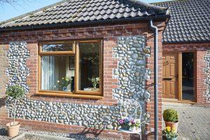 Golden oak exterior window and door