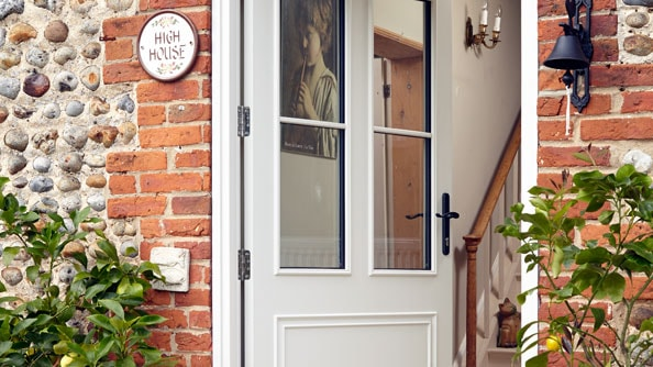 A pretty front door in White Knight with black furniture
