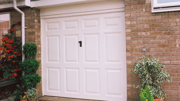 Sectional garage door in White