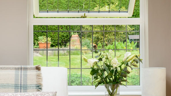 Elegant casement window in White Knight uPVC with decorative leaded glass