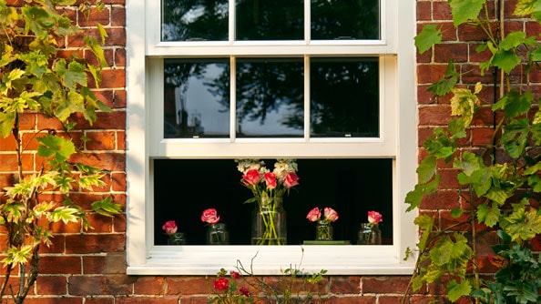 Delightful sash windows with cottage bars in White Knight uPVC
