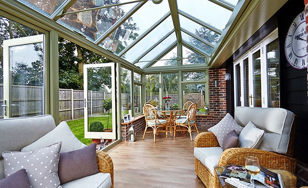 A wooden Edwardian conservatory in Sage Green