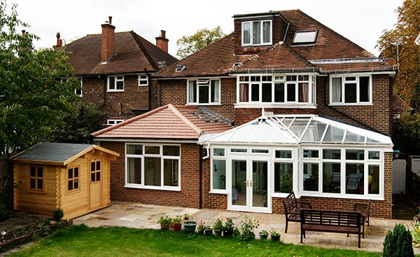 A combined extension and White uPVC conservatory