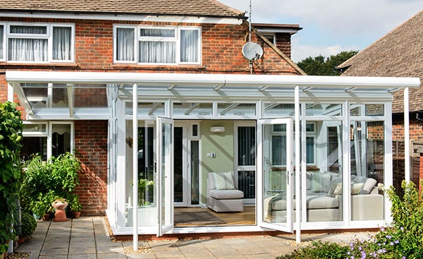 Large white uPVC veranda conservatory with French doors from the Anglian conservatory range