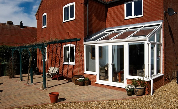 Small white uPVC lean to conservatory from the Anglian lean to conservatory range