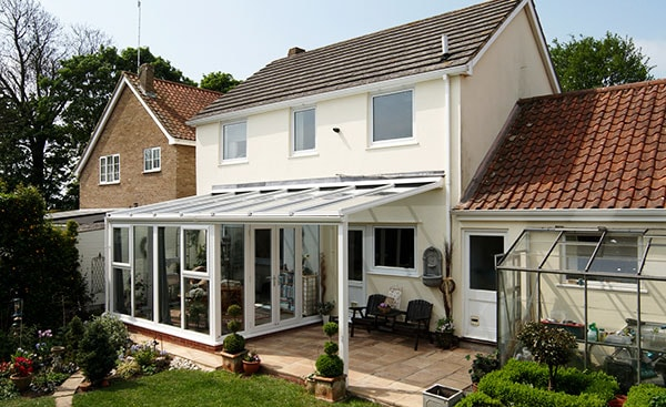 Garden view of White uPVC veranda conservatory from the Anglian conservatory range