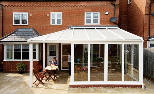 White uPVC veranda conservatory on modern home from the Anglian conservatory range