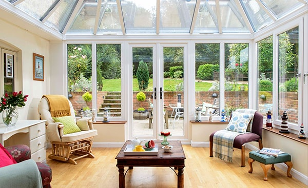 Large white uPVC Edwardian conservatory with French doors from the Anglian conservatory range