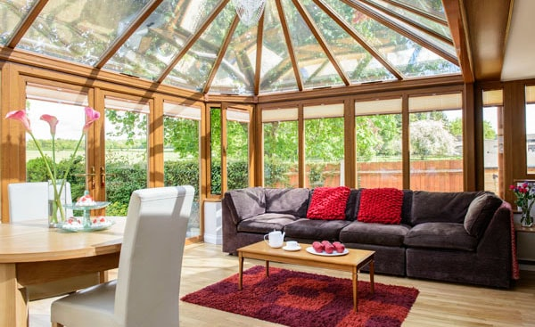 Interior view of large garden room conservatory in Golden Oak from Anglian Home Improvements
