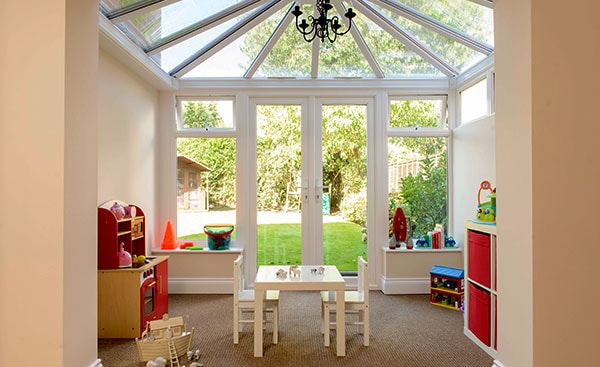 Interior view of small white uPVC orangery extension from Anglian Home Improvements