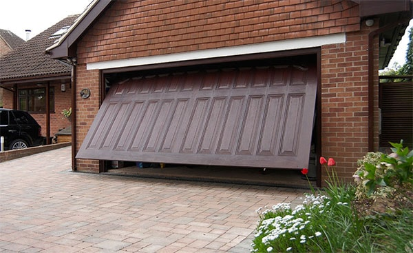 Dark Woodgrain GRP one piece garage door