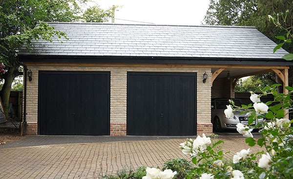 Two Black GRP one piece garage doors