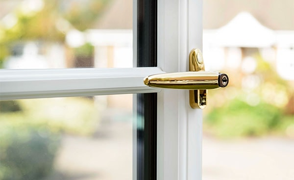 Gold handle on a White Knight uPVC window