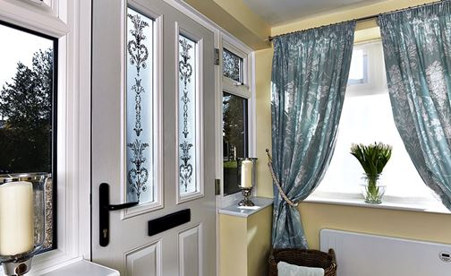 White GRP door with Laura Ashley decorative glass