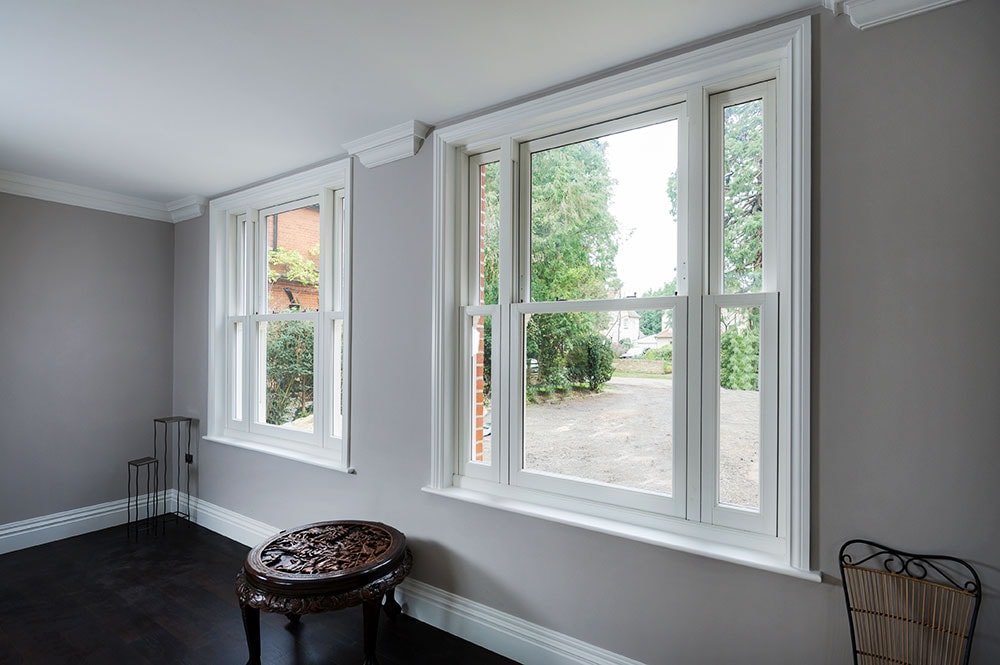 Pair of UPVC vertical sliding sash windows finished in White from the Anglian sliding sash window range