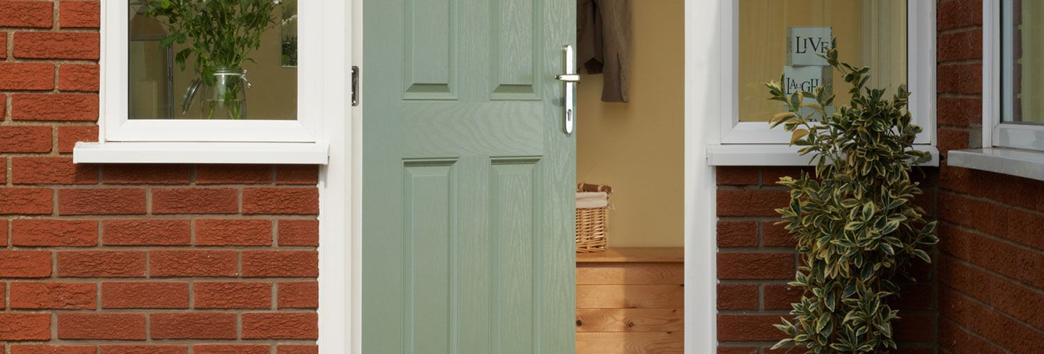 A Ripon GRP front door shown here in Eucalyptus with a chrome door handle